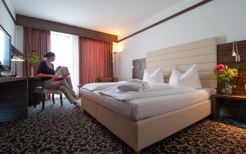 {c_qp_statement_title5}-Hochwertig ausgestattete Business-Zimmer